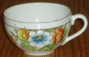 Marked Occupied Japan White Floral Pattern Teacup