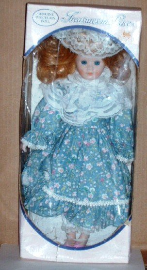 Treasures in Lace Genuine Porcelain Doll in Blue and White Flowered Dress