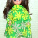 Small Doll with Green and Yellow Dress