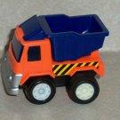 Orange and Blue Plastic Dump Truck Loose Used
