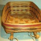 Henn Workshops 1998 entertainment sleigh basket with cranberry & green splints