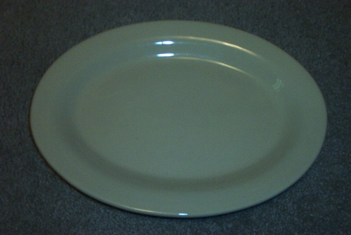 "Gerald E Henn Workshops cream 13"" oval platter"