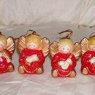 "4  Porcelain Angels Cmas Ornaments Size: 2 3/4"" H x 2 7/8"" W Price: 3.95"