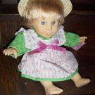 "11"" 1998 Wendy Gi-Go Toys Soft Body Gray Eyed Baby Doll with teeth in opened mouth wearing straw hat"