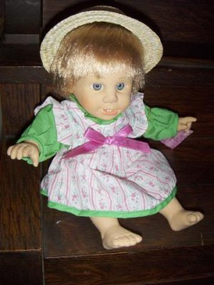 """11"""" 1998 Wendy Gi-Go Toys Soft Body Gray Eyed Baby Doll with teeth in opened mouth wearing straw hat"""