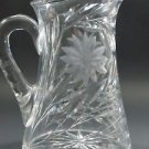 Wheel cut glass pitcher hand cut