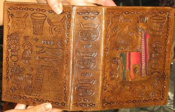 leather bound photo album,craved with Inca signs