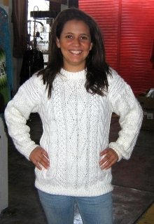 White sweater made of Alpaca wool, cable pattern