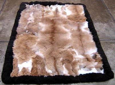 Soft baby alpaca fur carpet with a black boarder, 80 x 60 cm