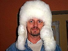 White fur cap, hat is made alpaca fur, outdoor