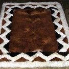 Brown alpaca fur rug with white Ornaments, 80 x 60 cm