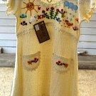 White baby dress from Ñusta, ekological pima cotton