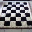 Designer alpaca fur rug, black and white, chess design, 220 x 200 cm