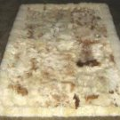 Baby alpaca fur rug with brown spots, from Peru 80 x 60 cm