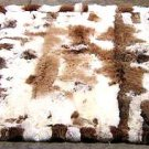 White and brown baby alpaca fur rug with very strong spots, 300 x 200 cm