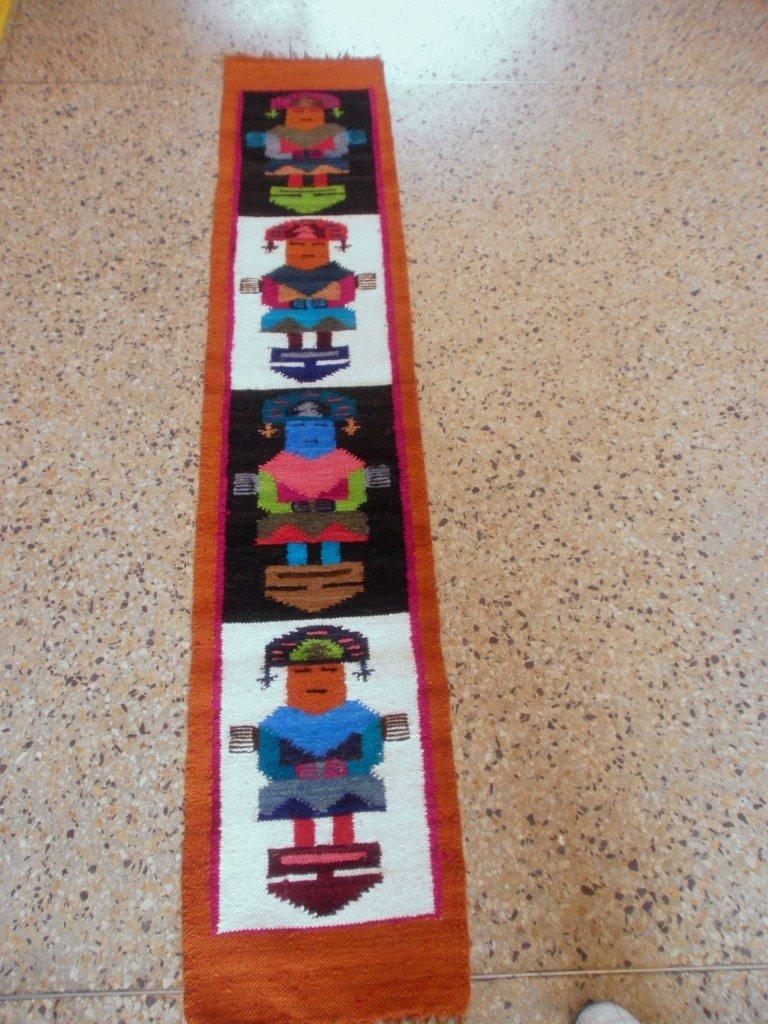 Peruvian hand weaved orange rug with Tumi Designs