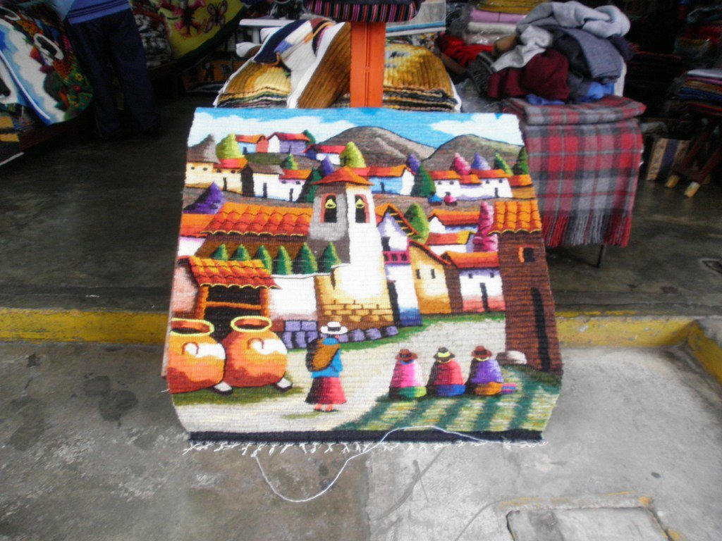 Traditionel hand weaved rug, peruvian women in a Village