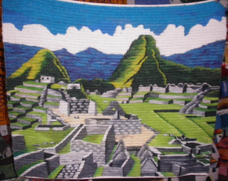 Traditionel peruvian hand weaved rug, ruins of Machu Picchu