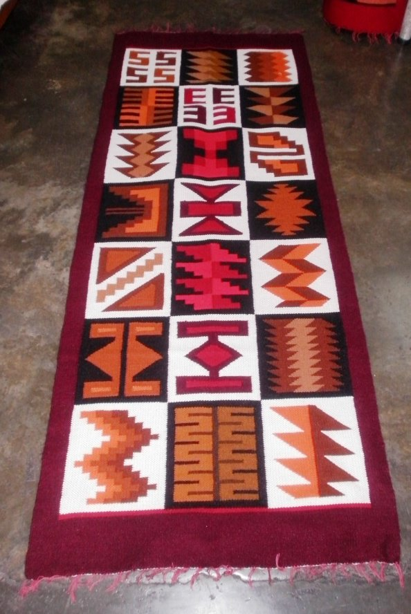 Peruvian hand weaved wool rug with native geometric designs