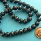 Desert Sun Beads Round 8mm Strand Black / Silver
