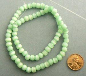Cats Eye Beads 5-6mm Grade C-D Strand - Light Green