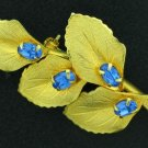 Classy Gold Tone Leaf and Blue Rhinestone Brooch Bro2166