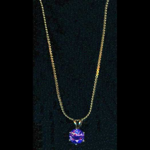 Gold-tone pendant with amethyst-like stone
