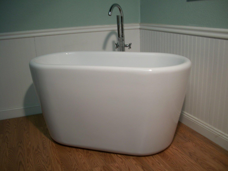 Freestanding Deep Soaking Tub.  Yaeko 52 Japanese Influenced Soaking Tub and Faucet