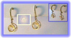 2ct champagne topaz half hoop 14k earrings.  Clever all year.