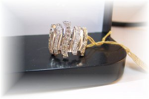 Columns of white and champagne diamonds.  Big presence.  18k right hand ring
