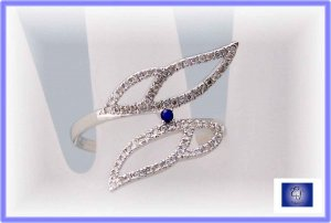 Modern Art.  Diamond and sapphire wings.  Right hand ring Sz 8.5