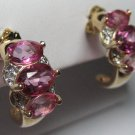 Faux pink sapphire / diamond earrings.  Heiress style.  Believable