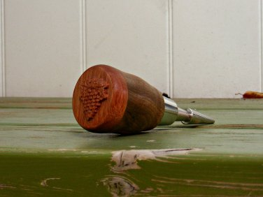 Bottle Stopper with Carving and is also Featured at; www.outofstep.com