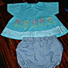 Blue Swing Top with Spring Flowers & free bottoms 24Mths