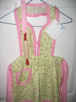 Lime green and pink children's apron with rolling pin