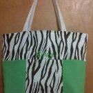 Brown zebra and green boy diaper bag