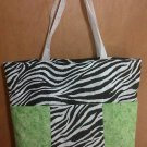 Black and white zebra with lime green diaper bag
