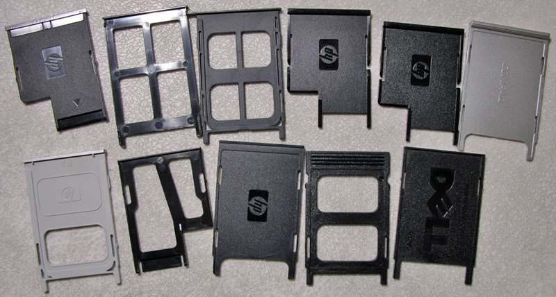 A LOT OF 18 OEM DELL HP COMPAQ PC PCMCIA SLOT FILLERS