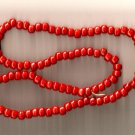 Crow Beads Glass Opaque Red Strand of 100 9x6 mm