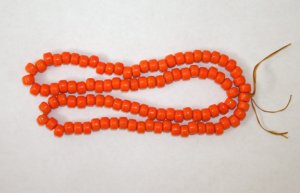 Crow Beads Glass Opaque Orange Strand of 100 9x6 mm