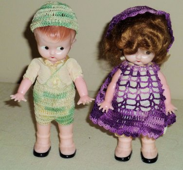 Pair of Vintage Plastic 6 Inch Kewpie Like Dolls with Side Glance Eyes Crochet Clothes