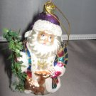 Santa Claus and tree and deer Christmas ornament