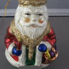 Santa Claus and basket and candle Christmas ornament