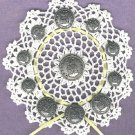 Crocheted doily decorated with vintage Air Force uniform  BUTTONS