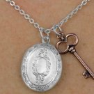 Oval Antiqued silver finish LOCKET necklace with copper tone key