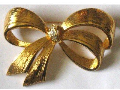 Gold tone Bow Pin Signed Avon, Rhinestone Center