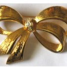 Gold tone Bow Pin Signed Avon, Rhinestone Center