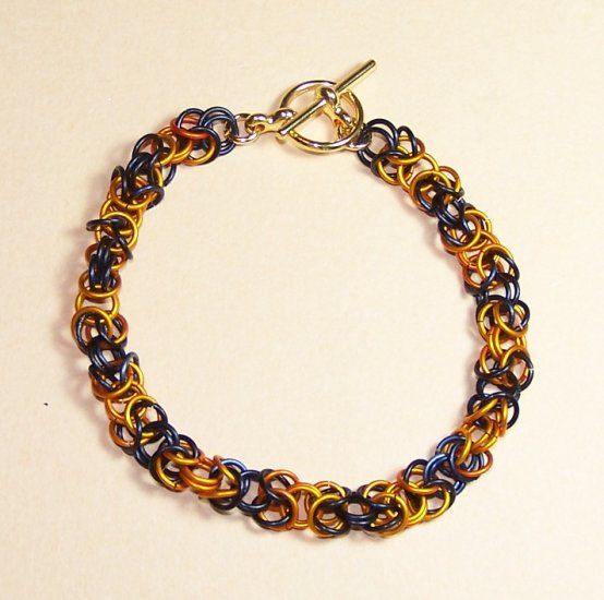 A-CH004-OBLK-G Black and Orange Chainmail Bracelet