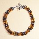 A-CH004-OBLK-S Black and Orange Chainmail Bracelet