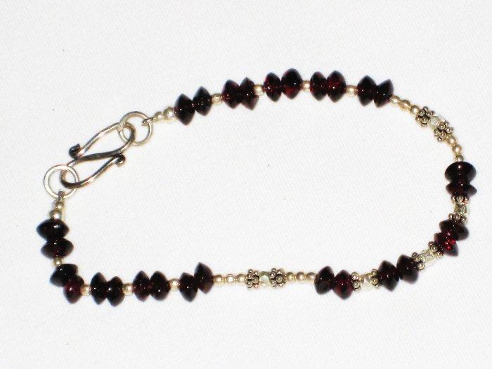 ST570 Garnet Bracelet in Sterling Silver